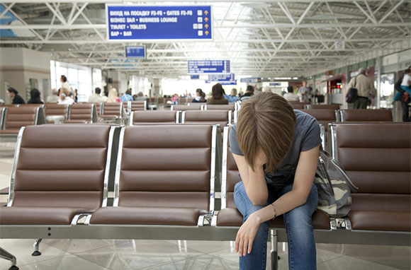 580x382_Exhausted-Young-Girl-Waiting-at-Airport