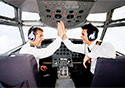 Pilots-Giving-High-Five-in-Airplane-Cockpi_SM