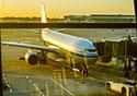 Plane-Waiting-at-Dusk-atBoarding-Gate-Window_SM