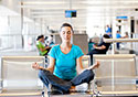 Young-Woman-Doing-Yoga-at-Airport-Gate_SM