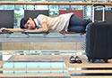 Asian-Woman-Sleeping-at-Airport_SM