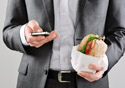 Man on Smartphone While Holding Sandwich-SM