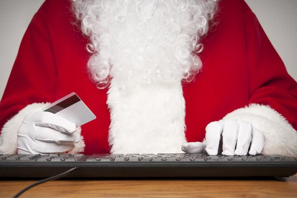 Holidays-SantaOnComputerHoldingCreditCard-DD
