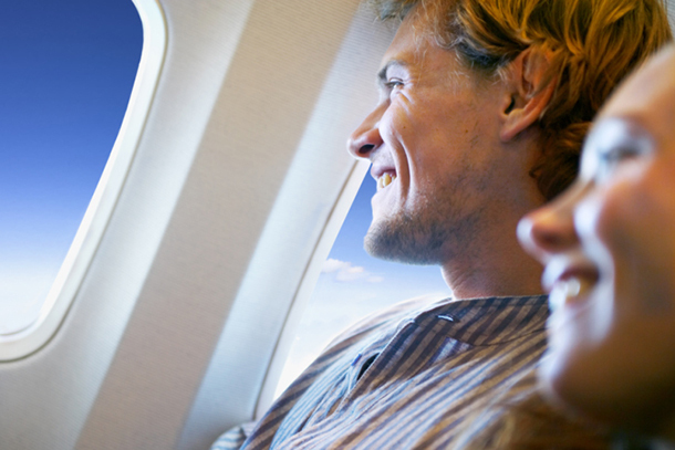 Airplane-passengerssmilingcloseup-dd